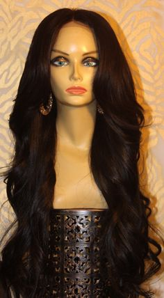 TreBella Wigs Brazilian Loose Wave closure unit 24in