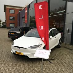 Old, Outlander plug in hybrid in black, versus new, Tesla Model X 75D in pearl white, full electric. No ICE (internal combustion engine).