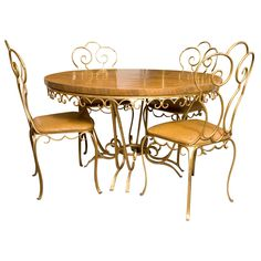 WANT.  Table and 6 chairs by Jean Charles Moreux, through The Collection Los Angeles.