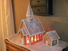 Gingerbread church with stain glass windows made from Lifesavers.