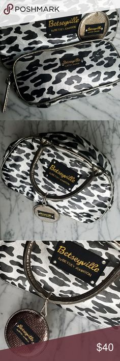 Betseyville Purse and Makeup Bag by B. Johnson Super cute vinyl animal print  purse and makeup bag from Betseyville by Betsey Johnson. Gold, silver, and black the purse measures approx 6 1/3 tall, 4 wide, and 11.5 strap. The bag is 1.25 wide, 8.5 long, and 3.5 tall Betsey Johnson Bags