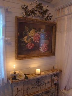 Love the porcelain roses over the rose painting.