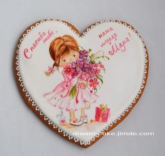 Girl with birthday presents hand-painted decorated cookie.  Cookie art.