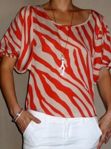Love this top with the new Stella & Dot Cameron Pendant! Get yours with us! www.stelladot.com/sites/wmboutique