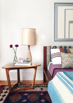 bedroom with mid-century side table and layers of pattern