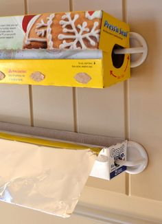 How to Organize Foil and Saran Wrap ~ using plastic hooks found at Walmart in the isle with the bathroom storage accessories