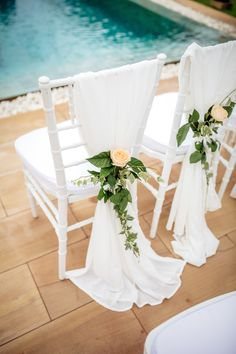 White tiffany chairs with white chiffon and peach rose and leaf tie backs Tiffany Chair, Chair Ties, Tiffany Wedding, Destination Wedding Planner, White Chiffon, Wedding Chairs, Rose Wedding, Wedding Venues, Wedding Ideas