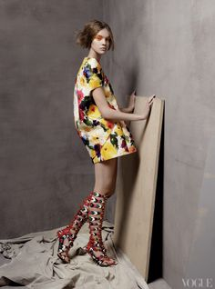 Rule number one for modernizing a floral print: Streamline the shape, saturate the colors, and add up-to-there gladiator heels. Balenciaga by Nicolas Ghesquière silk gazar jacket, minidress, and stilettos. Pictured: Natalia Vodianova.
