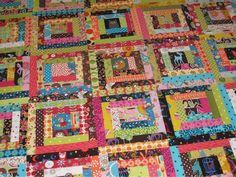 Scrappy Log Cabin - Made by KateN using 2 inch scraps of 70 different brightly coloured fabrics.