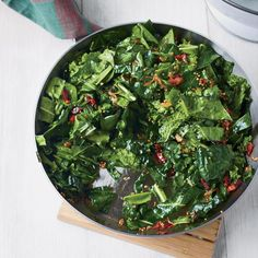 Sautéed Spring Greens with Bacon and Mustard Seeds | You can use any greens you like in this quick sauté, which gets terrific flavor and texture from smoky bacon, hot chile and the pop of mustard seeds.