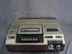 """Our first VCR was an RCA that resembled this Panasonic VCR Model PV-1200 (1978... Daddy's 40th b-day). It had an attached black cord with an """"On/Off"""" switch for remote recording."""