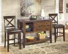With an inviting rustic design that is sure to enhance the dècor of any dining area, the Forner dining collection features a rustic burnished brown finish and grooved accents adorning the drop leaf top along with wooden knobs on the drawer fronts to perfectly capture the relaxed country look.