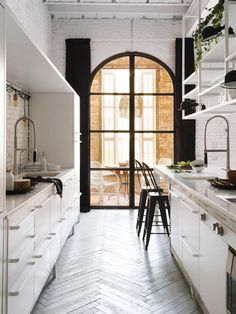 Barcelona apartment with white painted brick walls - dream kitchen