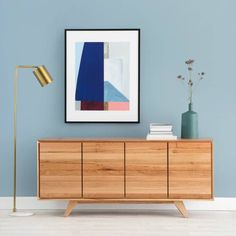 carson buffet from OZ design in tasmanian oak against blue feature wall with gold floor lamp