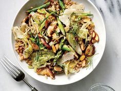 Make This Hearty Mushroom and Asparagus Grain Bowl In 25 Minutes | Grain bowls are so popular for good reason. They're the perfect solution for a fast weeknight meal. This vegetarian spring grain bowl has all the elements: pleasantly chewy farro, tender-crisp spring asparagus and fennel, and a big punch of flavor from lemon and Parmesan. Serve warm on a cool night or make it ahead and dish it up cold the next day. Look for precooked, ready-to-heat farro near other shelf-stable prepared…