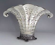 Tiffany Antique Sterling Silver Fan Shaped Pierced Vase 1902-1908.  A large Tiffany sterling silver pierced fan shaped Edwardian style vase with paw feet and an ornate die rolled band at the base. Fine piercing and applied borders decorate the fan shaped body on both sides.