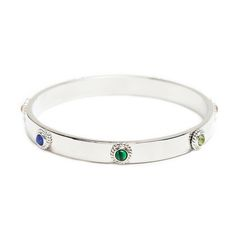 "Celebrate the beauty of multiple stones and hues with the Lara bangle. There's no need to decide between them with this classic stunner. Lara's bevy of alternating small, circular stones emanate big style and color.   - Silver tone metal, malachite  - 2 1/2"" diameter"