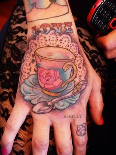 This incredible hand tattoo was done by Sam Rulz.
