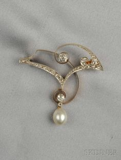 Art Nouveau Diamond and Pearl Brooch, Russia, set with old mine- and rose-cut diamonds suspending a pearl measuring approx. 10.50 x 8.50 mm, platinum-topped 18kt gold mount, lg. 2 1/8 in., hallmark.