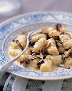 Gnocchi with Mushrooms and Gorgonzola Sauce - Pungent Gorgonzola melts beautifully into heavy cream and meaty sauteed mushrooms to make the rich sauce. The secret to making tender, ethereal gnocchi is to use a light touch and handle the dough as little as possible.