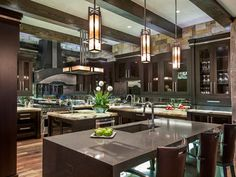 Kitchen - love the glass, the mirror/reflective backsplash and lighting - beam ceiling - incredible design | Interior Intuitions, Inc