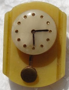 "BAKELITE CLOCK BUTTON - Collector Note: Appears to be celluloid or casein -two hole casein in this exact shape. I see the oily appearance of casein. Could be wrong. Is this a ""button on a button"" ? Collector mind is twirllng.. is this the glass clock on casein? I'd want to hold this one, and see the back. BTW, I was taught to learn materials, by sight, odor, touch, not hot needle. I very much appreciate celluloid, which is ruined with excessive heat. If this is original design, very cool…"