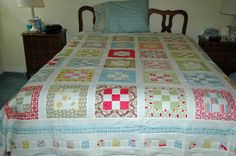 'Sweet Menagerie' nine-patch quilt. Love the colors