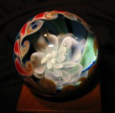 Blowfish Glassworks via Etsy: Floating Lotus Flower Glass Marble w/wooden stand- Contemporary Glass Art
