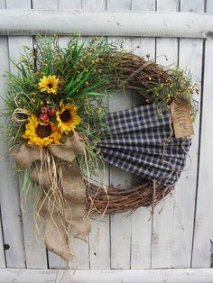 Summer Wreath - Fall Wreath - Autumn Wreath - Welcome Fall Wreath -Sunflower Wreath - Outdoor Wreath - Rustc Wreath - Primitive - Country Wreath Country Summer or Fall wreath with navy blue fabric & yellow sunflowers. Has primitive look with berries, greenery, moss, raffia burlap bow, on a grapevine wreath. The grungy Welcome Tag adds just that finished touch. Wreath dimensions are: 21 - 22 inches in diameter - 6 inches deep.