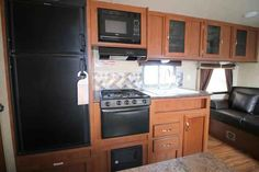 2016 New Forest River Wildwood 241QBXL Travel Trailer in California CA.Recreational Vehicle, rv, 2016 Forest River Wildwood241QBXL, 6 Gal. Gas DSI Water Heater, Black tank flush, Cable/Satellite TV Ready, Coach-Net Roadside Assistance, Decorative Curtain Rods, Double door refrigerator, DVD, MP3, CD, FM Stereo, EZ Lube Axles, Foot Flush Toilet, Full Extension Drawer Guides, Glass Shower Door, LED Awning Strip, Made in USA Decal, Night shades, Outside Shower, Pass Thru Storage, Power Awning…