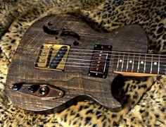 """Postal Guitars: """" This is made from Barn-wood found near the highway 61 cross-roads in the Mississippi delta. It sounds incredible. It has a Fatboy P90 at the neck and a fender American Tele bridge pickup. The body is chambered and light."""""""