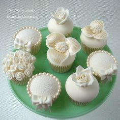 Our range of deluxe cupcakes to match the Lace and Pearl cake uploaded a couple of weeks ago. https://www.facebook.com/Cleverlittlecupcake