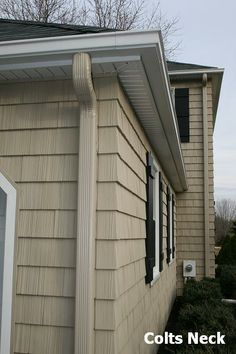 Englert Rain Pro white seamless aluminum gutters and wicker aluminum downspouts in Colts Neck, NJ