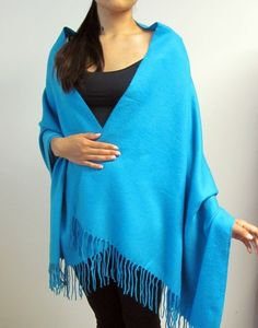 A turquoise shawl - beautiful elegant and classy for day and evening wear. Available in different yarns to suit all seasons so women can have seasonal shawls to cherish.  http://www.yourselegantly.com/catalogsearch/result/?q=turquoise+shawl