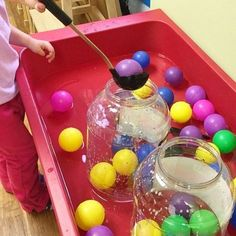 Ball and water activity bin. Help toddler work on motor skills and hand eye coordination!