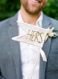This groom is too sweet with his glitter sign. We love this wedding day photoshoot idea!