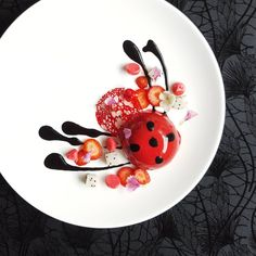 Red ladybug - black sesame mousse, strawberry jelly, black sesame dacquoise, dragon fruit and meringue.