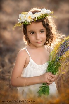 Portrait of beautiful girl with flowers in her hair, by Cyprus Newborn and Family photographers Andreas and Alexia Photography