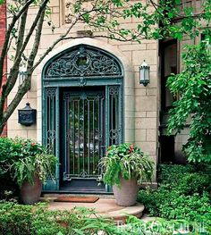 We love the ironwork entrance of this Chicago townhome! - Traditional Home® / Photo: Werner Straube / Architect: Rugo/Raff Architects