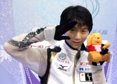 Yuzuru Hanyu, Japan, carries Pooh everywhere as his good luck charm. Good kid.