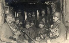 15 German soldiers in a dug out waiting for an enemy artillery barrage to lift, c. 1917.