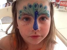 Peacock face paint. This one is so cute!
