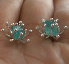 Rough apatite sea anemone stud earrings, raw gemstone, gorgeous watery-blue, OOAK. $48.00, via Etsy.