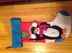 Customized Penguin Christmas stocking on Etsy. Can be made with primary or bright colors. Customized with eye color and name. Love!