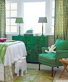 "The inspiration for the girls' room in a Lattingtown, New York, house was their green chest.  Meg Braff says. ""These greens are little-girly but sophisticated enough to grow up with."" The chair is covered in Scalamandré's Watermark. Curtain fabric, Sister Parish Design's Dolly; Elysée tassel fringe, Samuel & Sons. John Robshaw throw."