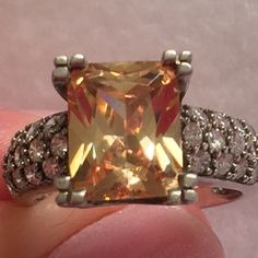 Sterling Ring w Lg Yellow/Peach & white Crystals Beautiful Yellow Peach Crystal Sterling Silver Ring w Small Crystals NWOT vintage. See pics for weight and size. Condition: Pre-Owned, Good, Wear Consistent w Age.  Thank You for visiting BlackBeards Lost Treasure App Store of Urbandale Iowa where all Treasures are Pre owned/used, examined, & researched (5>=90 hrs). We have spent hours searching the USA for our Treasures. Our Treasures were all pre-loved and were cherished buy someone in…