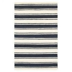 """Anchor your living room seating group or define space in the den with this artfully crafted rug, showcasing a bold stripe motif in navy and white.    Product: RugConstruction Material: New Zealand wool and polyesterColor: Navy and white  Features: Hand-tuftedMade in India Pile Height: 0.25"""" Note: Please be aware that actual colors may vary from those shown on your screen. Accent rugs may also not show the entire pattern that the corresponding area rugs have."""