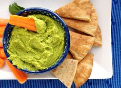Cilantro-Lime Hummus:        Put 1 1/2 cups of chickpeas into the bowl of a food processor.      Add about a quarter cup of olive oil.    Toss in a handful of cilantro      Add a clove or two of garlic.      Add a good pinch of ground cumin   Squeeze in the juice of two limes.      Add a bit of salt.      Process until super smooth.          Serve with baked tortilla chips, pita bread