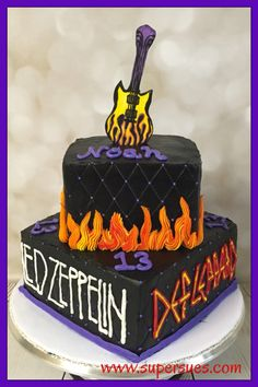 Rock n' Roll themed 2 tier birthday cake. Led Zeppelin Def Leppard AC/DC and the Rolling Stones, complete with flames and edible guitar!