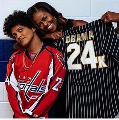 """#Repost #Instagram @solraemi Thank u to those helping any way they can with the #crisis in #PuertoRico and the #Caribbean. You're spreading kindness the world needs."""" #BrunoMars with former #FirstLady #MichelleObama at his #concert in #DC on Friday September 29, 2017 #SomosUnaVoz #ObamaFoundation #OneAmericaAppeal MichelleObama was backstage at the Capital One Arena (formerly the Verizon Center"""